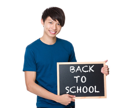 phrases: Asian man with the blackboard showing phrases of back to school Stock Photo