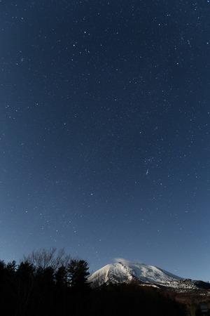 starry night: Starry night with snow mountain Stock Photo