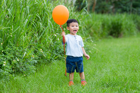catch up: Asian kid catch up with his balloon