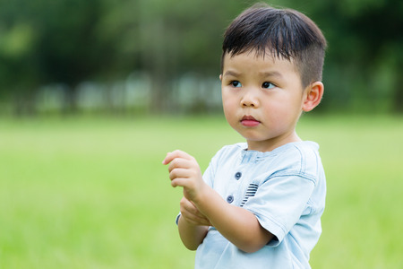 itchy: Asian Baby boy feeling itchy on hand Stock Photo