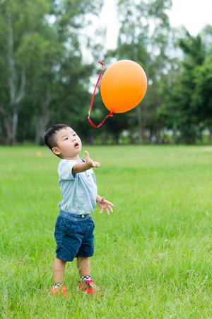 release: Little boy release his balloon