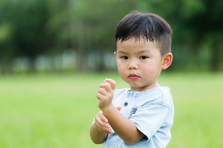 itchy: Asian boy feeling itchy on his hand Stock Photo