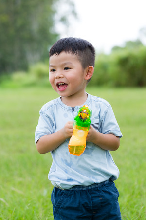 excite: Excite little boy play with bubble blower