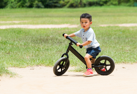 asian trees: Baby boy riding with balance bicycle