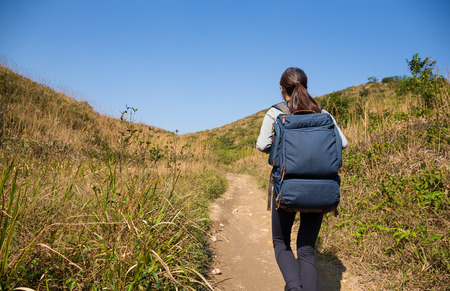 adventuring: Back view of woman go hiking