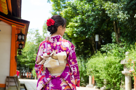 The back view of Young Woman wearing the kimono dress 스톡 콘텐츠