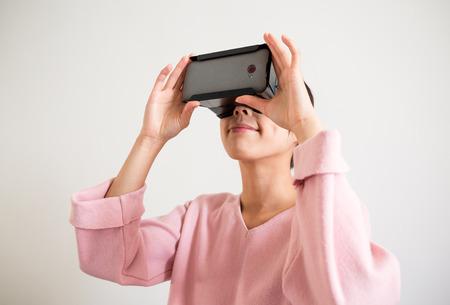 uses: Girl uses head-mounted display Stock Photo