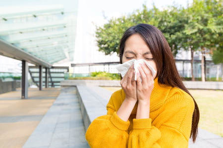 woman blowing: Sick young woman blowing her nose