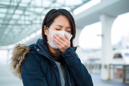 japanese people: Asian woman wear face mask in pollution city