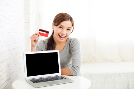 selling points: Woman holding credit card for online shopping