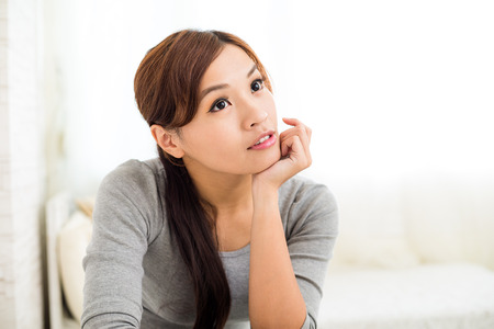 woman sitting on chair: Woman think of something