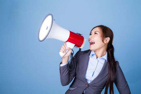 formal dressing: Businesswoman making announcement with megaphone