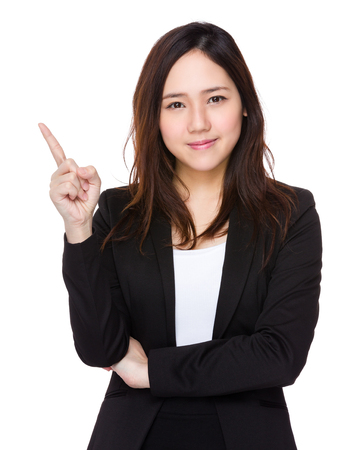 business suit: Asian businesswoman with finger point up
