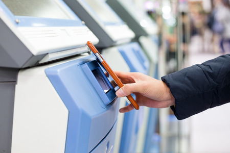 paying: Woman using mobile phone for paying on machine