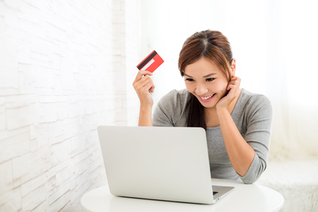 paying: Woman shopping online