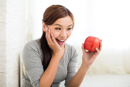 ot: Woman love ot eat apple Stock Photo