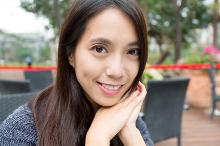 outdoor restaurant: Young woman in outdoor restaurant Stock Photo