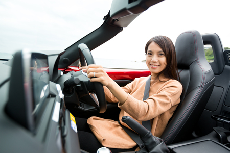 temptress: Woman sitting in cabriolet