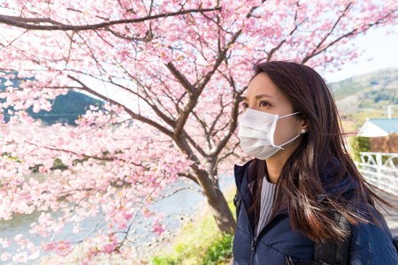 allergy: Woman wearing face mask protect from pollen allergy