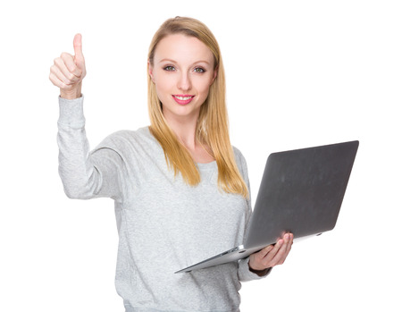 sweatsuit: Caucasian woman hold with notebook computer and thumb up