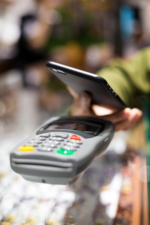 nfc: Mobile payment by NFC Stock Photo