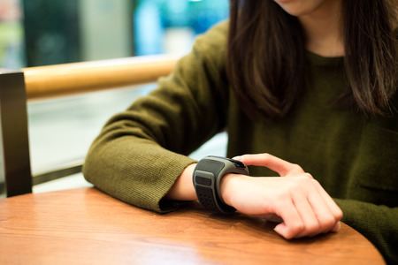 girl with a wristwatch: Woman touch on the smart watch