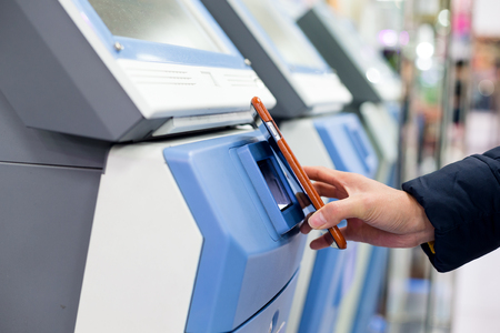 ticketing: Woman pay with cellphone by NFC on ticketing system