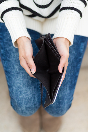 empty wallet: Woman with an empty wallet