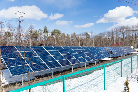 clear day in winter time: Solar panel plant in winter time Stock Photo