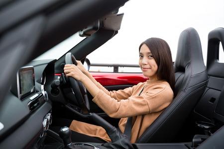 top down car: Woman driving car