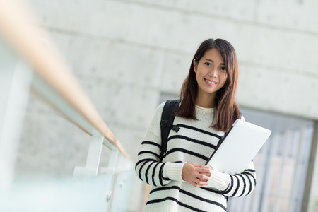 Woman hold laptop computer