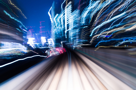 speedy: Speedy train passing though in city at night Stock Photo