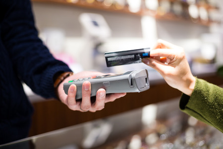 Woman paying with NFC technology on credit card