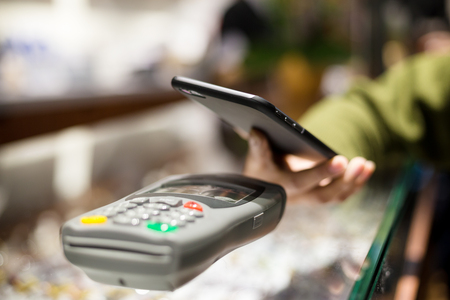 wireless terminals: Woman using mobile phone for pay the bill