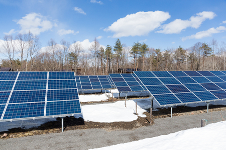 clear day in winter time: Solar panel station in countryside