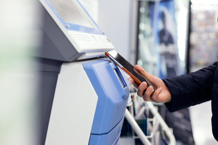 ticketing: Woman connecting cellphone and ticketing machine
