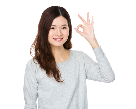 sweatsuit: Young Woman showing ok sign gesture