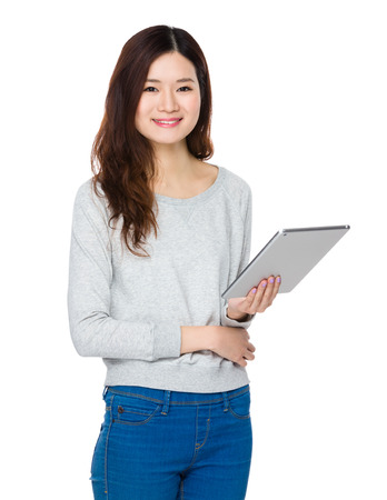 sweatsuit: Woman use of the tablet pc