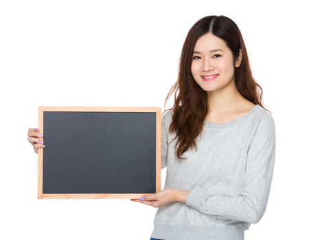 sweatsuit: Young Woman showing with chalkboard Stock Photo