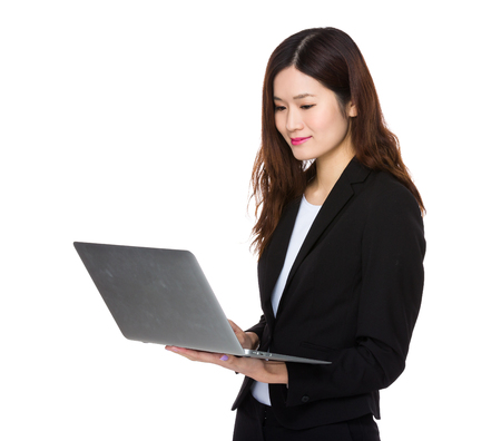 working on computer: Asian Young Businesswoman working with laptop computer