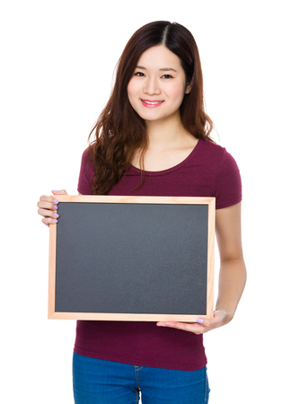 blank chalkboard: Woman showing blank chalkboard Stock Photo