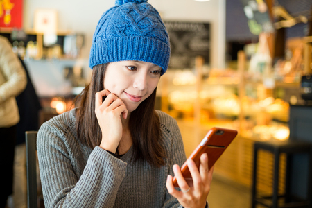 mobile telephone: Woman use of mobile phone at coffee shop Stock Photo