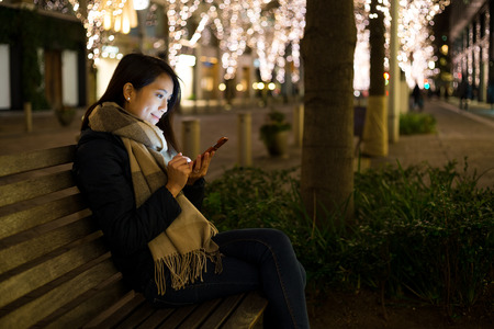 phone message: Woman use of mobile phone at night