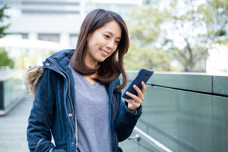 young adult: Young woman look at cellphone