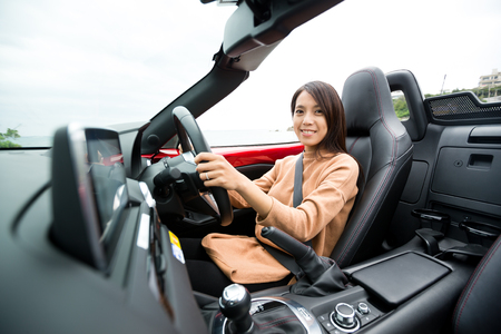convertible: Young woman on convertible car Stock Photo