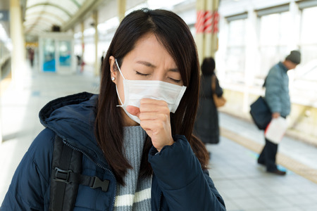 suffer: Woman suffer from sick with wearing face mask