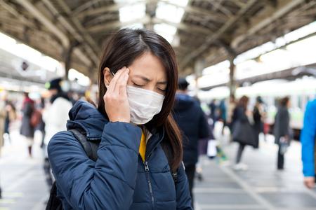 transmissible: Woman feeling unwell in train station