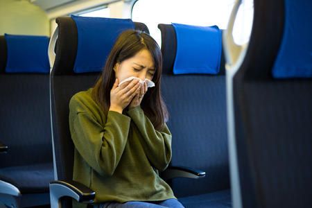 compartment: Woman sneeze on train compartment Stock Photo