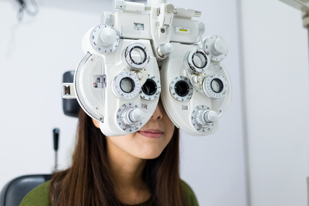 Woman doing eye test in medical office Stock Photo