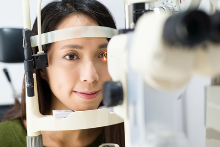 medical attendance: Young woman is having eye exam Stock Photo